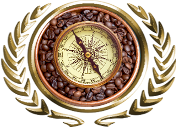 compass atop a bowl of roasted coffee beans set inside gold laurels